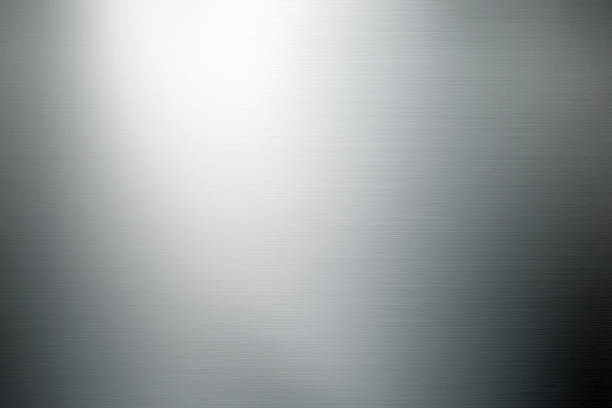 shiny brushed metal background close up shot of brushed metal surface. metal stock pictures, royalty-free photos & images
