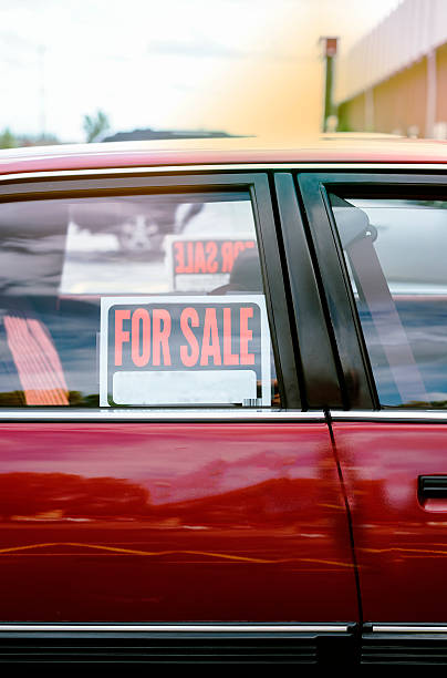 shiny car for sale in summer weather stock photo