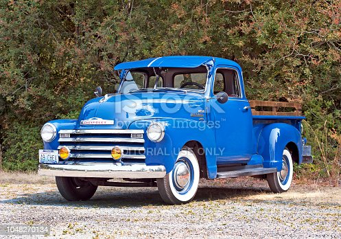 Lopez Island, Washington State, USA. Old traditional classic restored and polished Chevy pickup truck in blue with shiny chrome bumpers and grill on Lopez island
