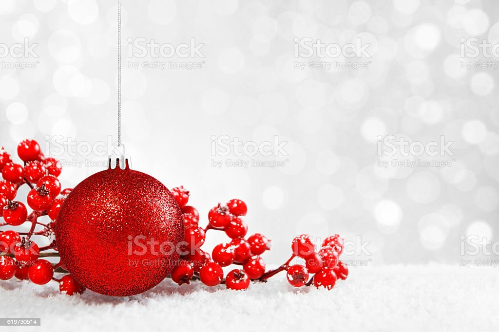 Shiny Christmas Bauble with Snowy Background stock photo