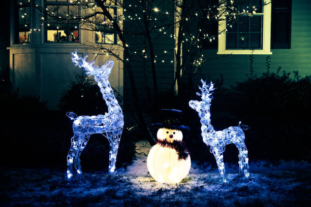 shiny Christmas decorations outside at night stock photo