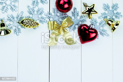 istock Shiny Christmas holiday ornaments on white wood background 622964432