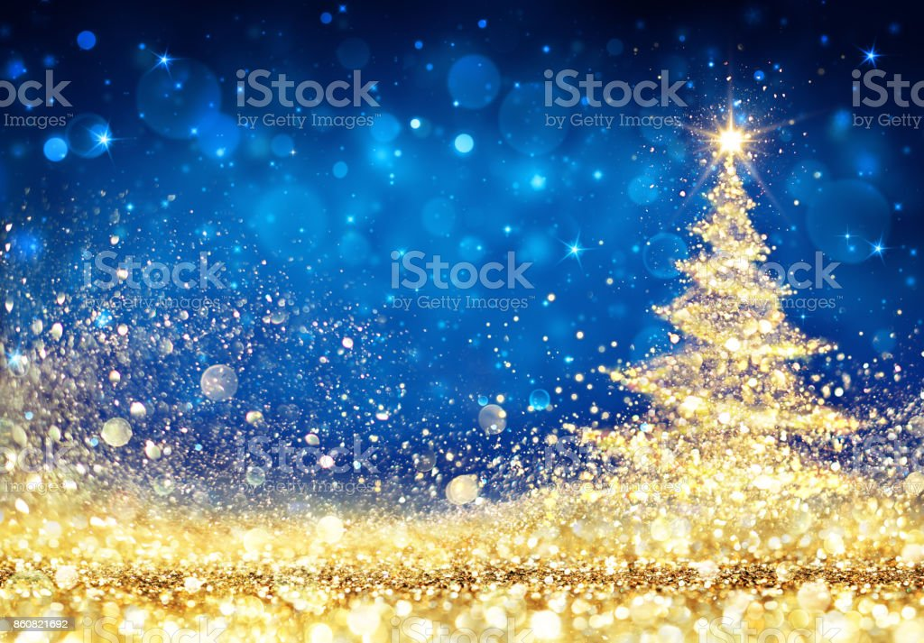 Glänzende Weihnachtsbaum - goldenen Staub Glitzern auf blauem Hintergrund – Foto