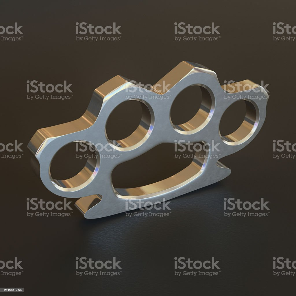 Shiny Chrome Knuckle Duster On Black Surface stock photo