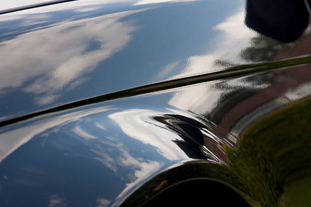 Shiny close-up of a vehicle which is reflecting the sky Effect before and after polishing lacquered stock pictures, royalty-free photos & images