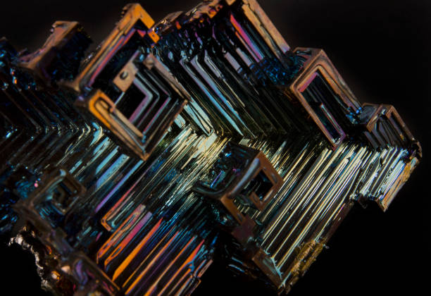 Shiny colorful mineral bismuth on a dark background stock photo