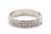 Shiny gem encrusted bracelet resting on its side