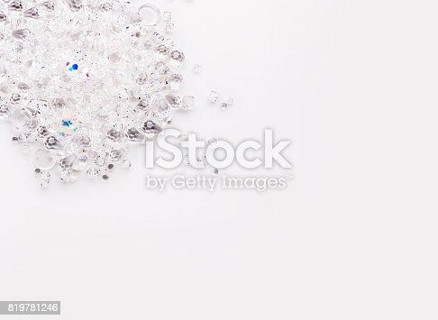 istock Shiny glass beads on white background 819781246