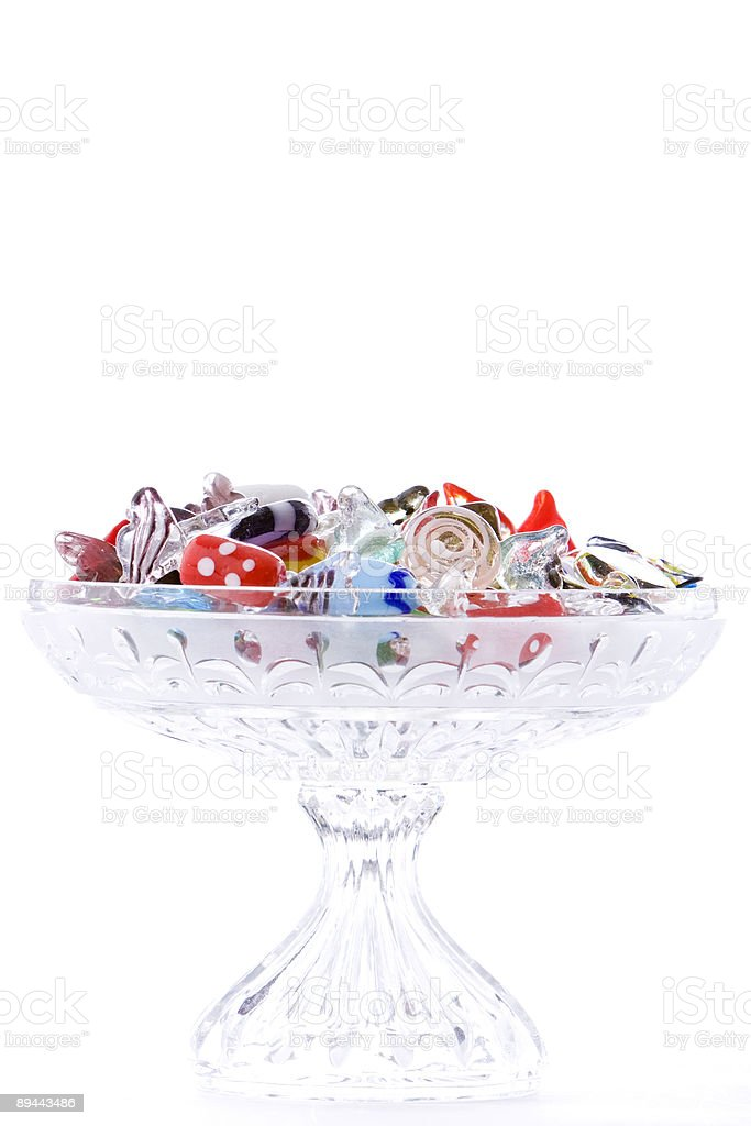 Shiny Glass Candy in Crystal Dish Isolated on White royalty-free stock photo
