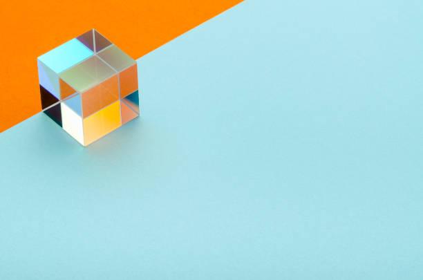 shiny glass cube on a blue-orange background