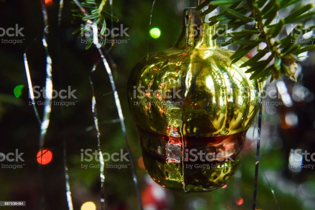 Shiny Gold Bell Christmas Ornament Hanging in Christmas Tree stock photo