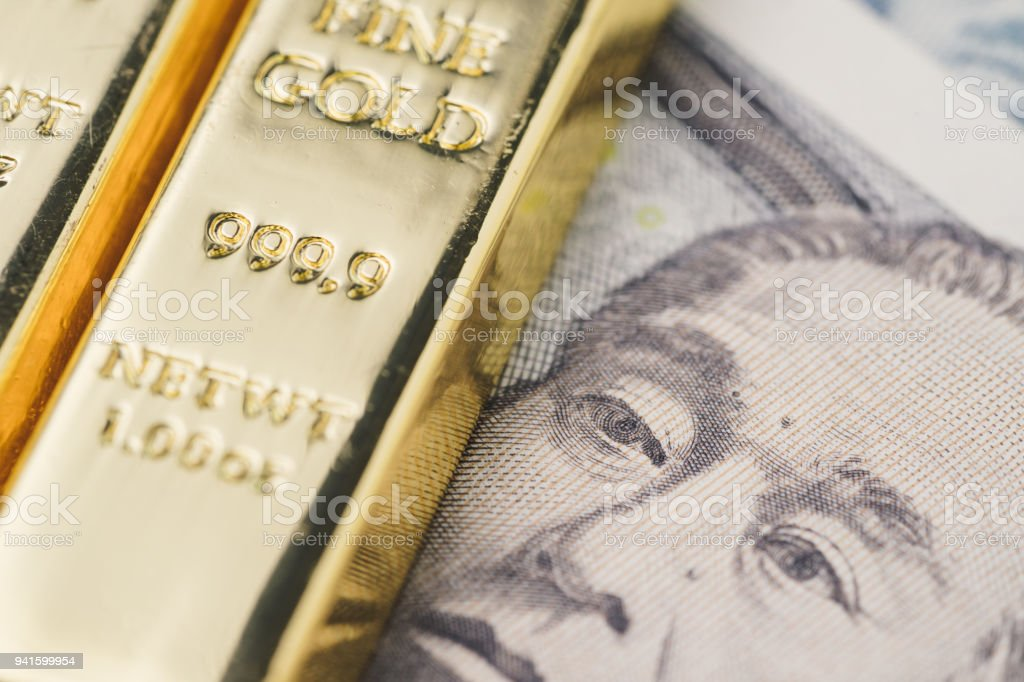 Shiny gold bullions ingot stack on Japanese yen banknote money as financial asset, investment and wealth concept stock photo