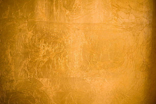 A shiny gold textured background stock photo