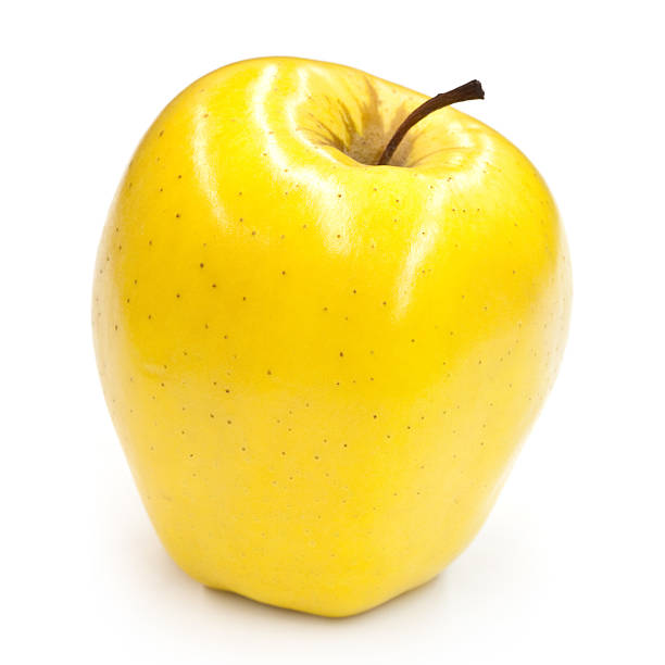 brillant pomme golden delicious - golden photos et images de collection