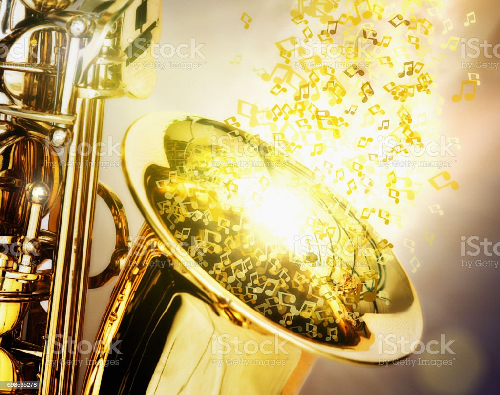 A shiny golden saxophone with bright musical notes floating out stock photo