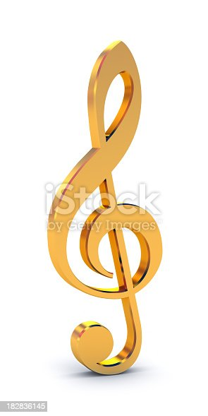 Gold treble clef isolated on white.