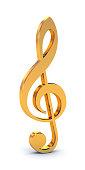 Shiny, golden treble clef free-standing symbol on white