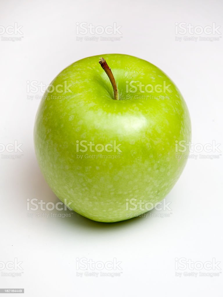 Shiny green apple with stalk isolated on white stock photo