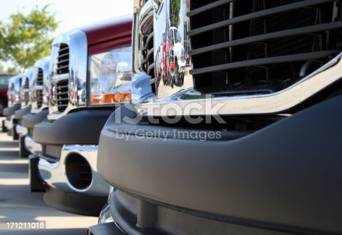 133277230 istock photo Shiny Grids On Front Of New Trucks At Car Lot 171211018