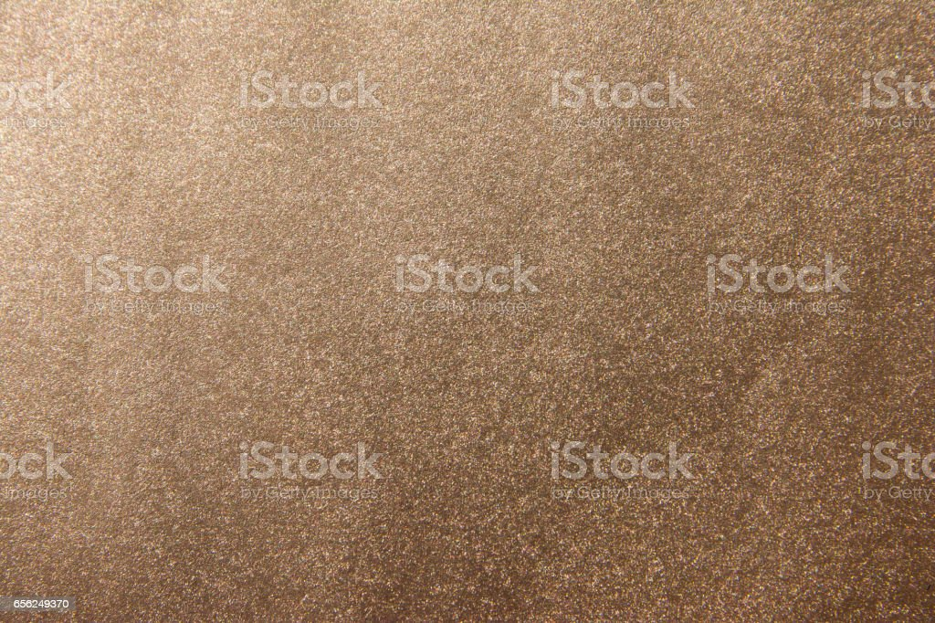 Shiny leaf gold foil texture background. Brown gold texture background stock photo