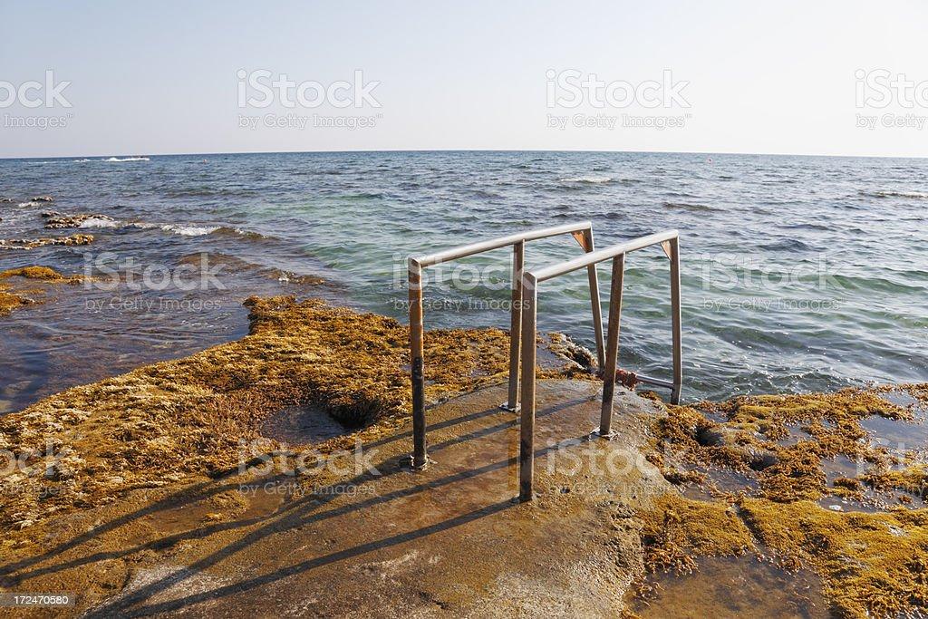 shiny  metal handrail at blue mediterranean beach Ayia Napa Cyprus royalty-free stock photo