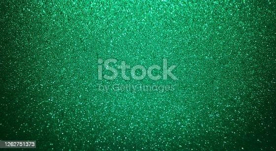 Shiny mint green glitter texture background