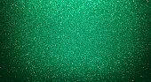 istock Shiny mint green glitter texture background 1262751373