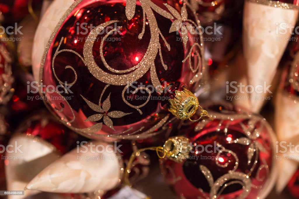 Shiny red and white christmas tree balls with golden ornament stock photo