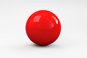 A shiny red ball with shadow on a white background