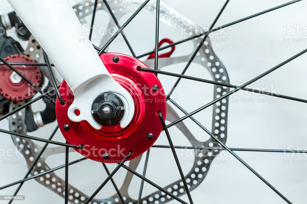 Shiny Red Bike Hub And White Fork stock photo