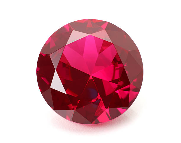 a shiny red ruby gemstone on a white background - smyckessten bildbanksfoton och bilder