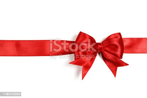 Open white gift box tied with red ribbon on red background. Horizontal composition with copy space. Directly above. Great use for Christmas and Valentine's Day related gift concepts.