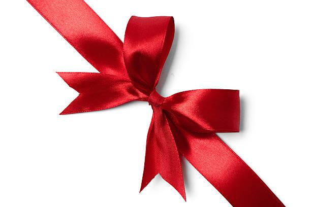 glänzende rote satin-schleife auf weißem hintergrund - geschenkschleife stock-fotos und bilder