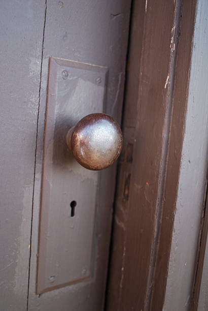 shiny rusted old door knob stock photo