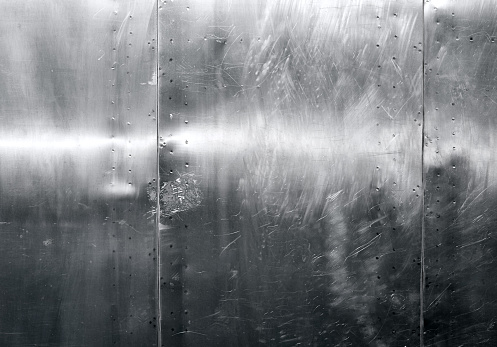 Shiny scratched metal surface close up