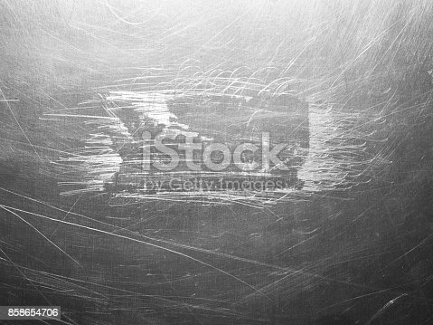 istock Shiny scratched metal surface close up 858654706
