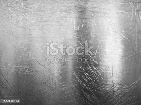 542685294istockphoto Shiny scratched metal surface close up 899931314