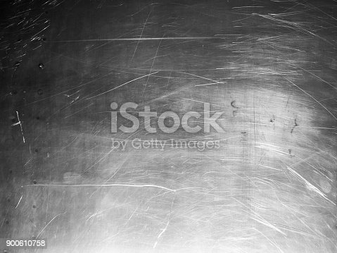 542685294istockphoto Shiny scratched metal surface close up 900610758