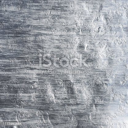 542685294istockphoto Shiny scratched metal surface texture background 1172990664