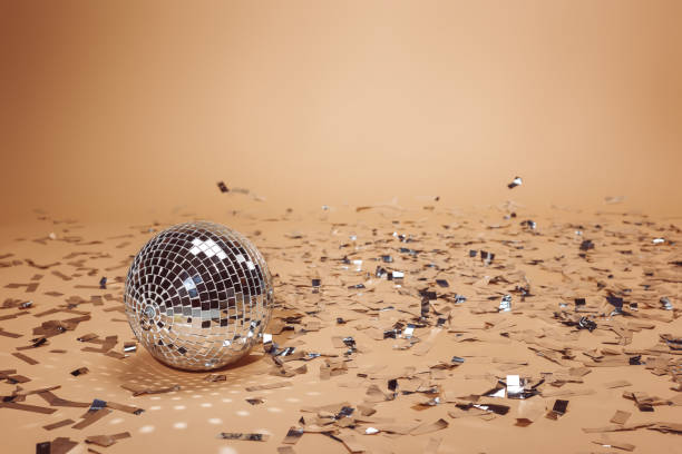 shiny silver disco ball and falling confetti on beige - disco ball stock pictures, royalty-free photos & images
