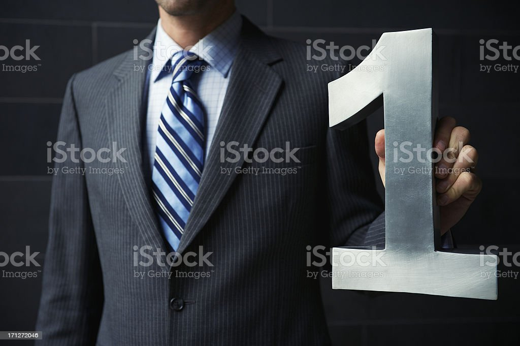 Shiny Silver Number One Businessman Dark Suit Success stock photo