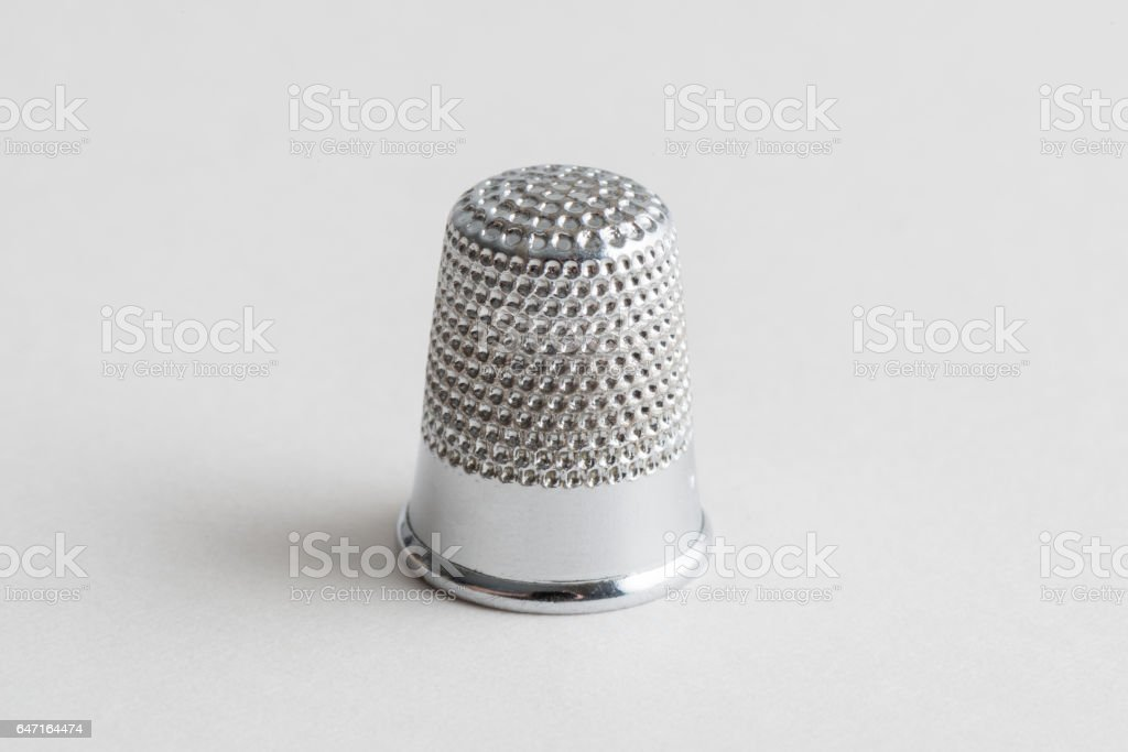 Shiny Silver Thimble on a White Background stock photo