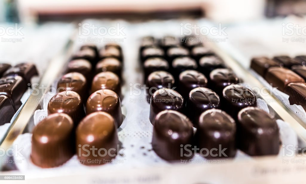 Shiny smooth gourmet chocolate truffles on a tray in bakery stock photo