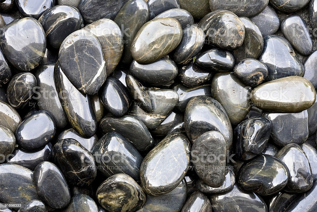 Shiny smooth river rocks stock photo more pictures of for Smooth landscaping rocks