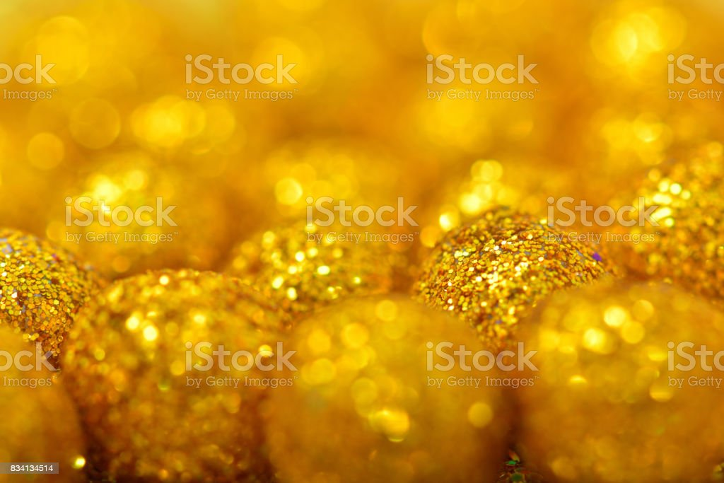 shiny sphere made of golden glitters with sparkles and glares stock photo