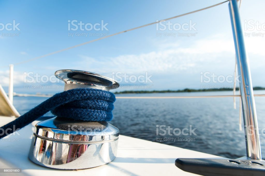 Shiny tackle on white yacht desk during the ocean voyage. stock photo