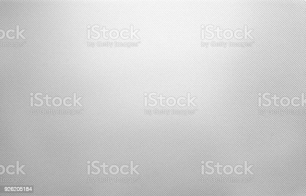 Photo of Shiny white metal texture, dotted silver background