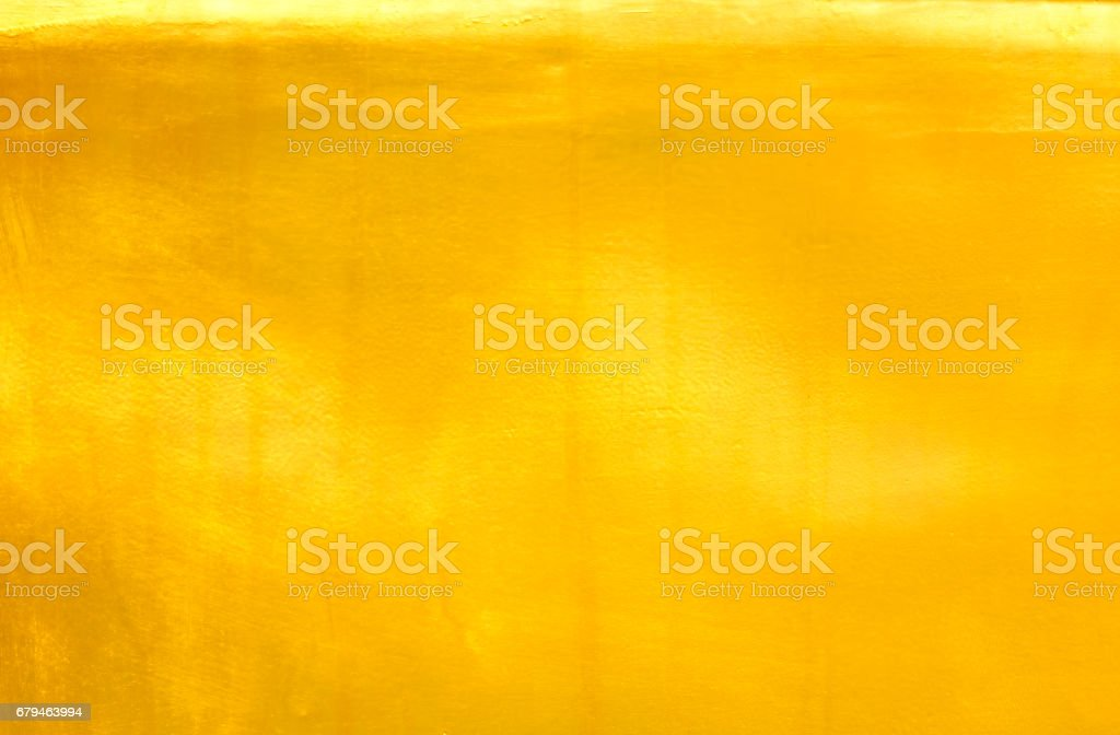 Shiny yellow leaf gold foil texture royalty-free stock photo