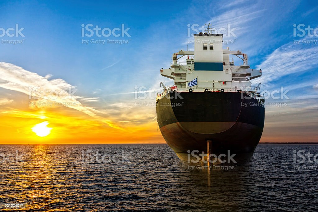 Ship and sunrise stock photo