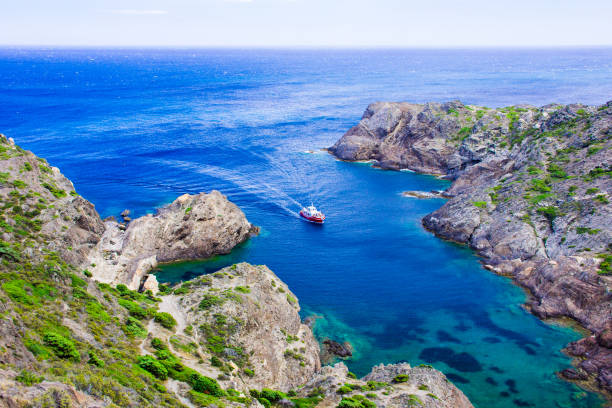 Ship at Cap de Creus, Girona, Catalonia. Ship at Cap de Creus, cape in Cadaques, Girona, Costa Brava, Catalonia, Spain. The most eastern point of Spain and the Iberian Peninsula. Mediterranean coastline. headland stock pictures, royalty-free photos & images